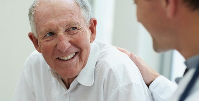 Senior Talking to Doctor About Kinesiology