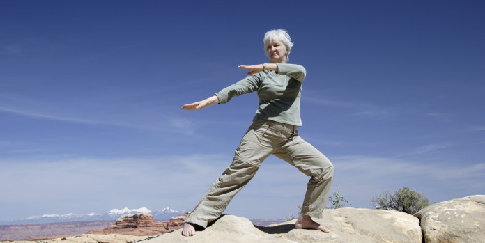Eldery Womam Doing Tai Chi for Balance Training
