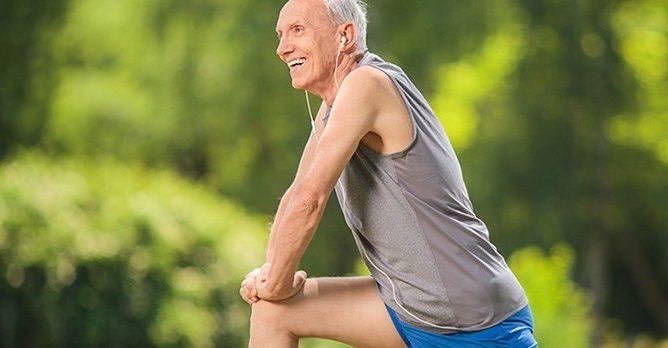 Senior Man Stretching After Run Sun
