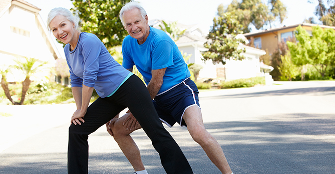 Elderly Couple Stretching Together